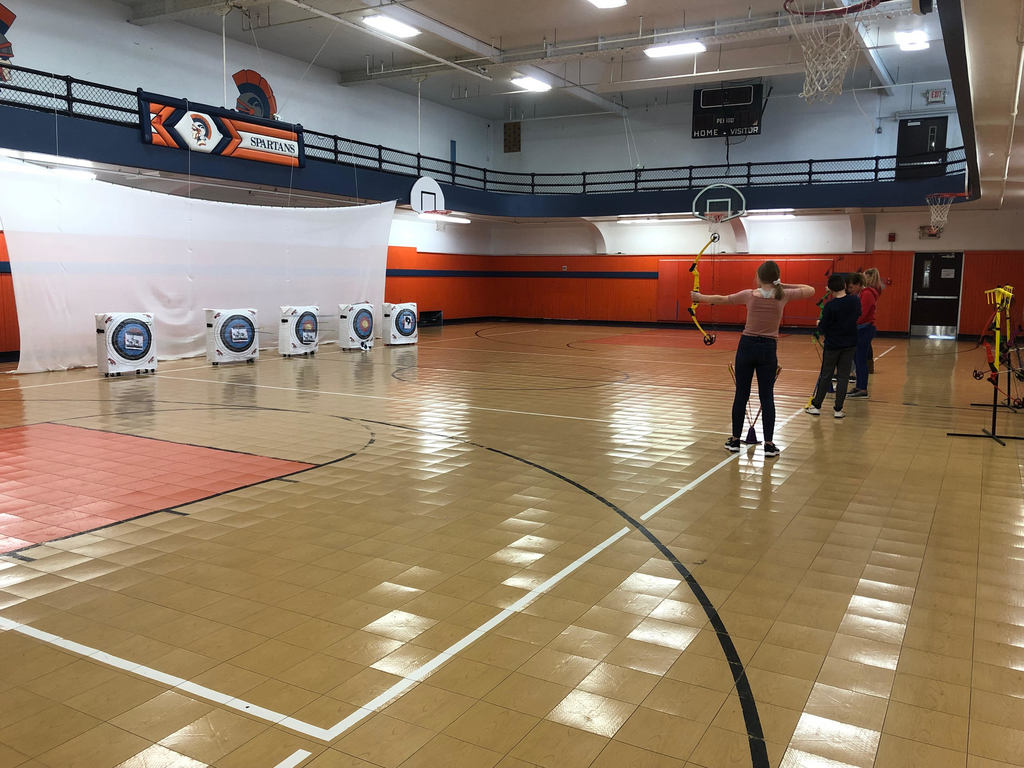 All of the PE classes are working on their archery skills